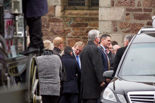 Taoiseach Enda Kenny at the funeral service of Sylvia and Thomas Connors and their three children, Jim, Christy and Baby Mary in Wexford Town. Pic:Mark Condren