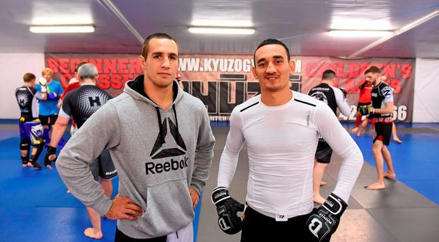 UFC fighters Rory MacDonald, left, and Max Holloway in attendance at a UFC Community Seminar at Kyuzo Gym, Glasnevin, Dublin. Picture credit: Stephen McCarthy / SPORTSFILE
