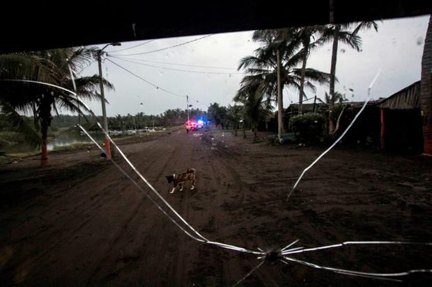 View of street at Boca de Pascuales were residents are evacuated by local authorities Credit: HECTOR GUERRERO (AFP)