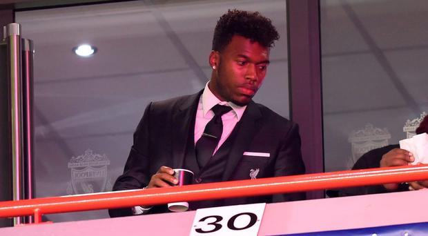 The injured Daniel Sturridge watches from the stands during Liverpool's 1-1 draw with Rubin Kazan