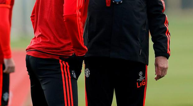 Manchester United's manager Louis van Gaal and Anthony Martial during training this week