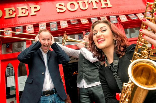 Musicians Tomas McCarthy and Clodagh Kearney with Rory Sheridan from Diageo as the Jazz Festival gets under way in Cork