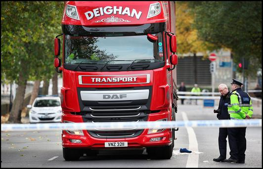 A trainer at the scene of the accident where a man became trapped under a truck on Merchant's Quay in Dublin. Picture: Steve Humphreys