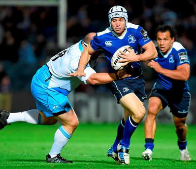 Leinster's Isaac Boss is tackled by Mike Cusack of the Glasgow Warriors