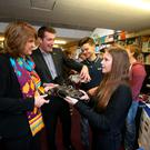 Fionnuala Moran (17) and Cian Wisdom (16) show their metalwork skills to Tánaiste Joan Burton and Minister for State Aodhán Ó Ríordáin on a visit to Mount Temple Comprehensive Secondary School in Clontarf yesterday