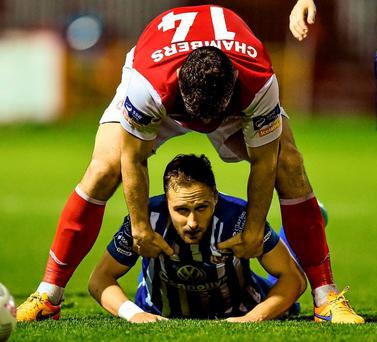 St Patrick's Athletic's James Chambers helps Sligo's Sander Puri to his feet during last night's Premier Division clash at Richmond Park