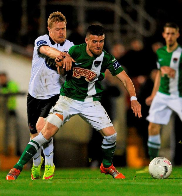 Cork City's Steven Bettie battles for possession with Dundalk's Daryl Horgan
