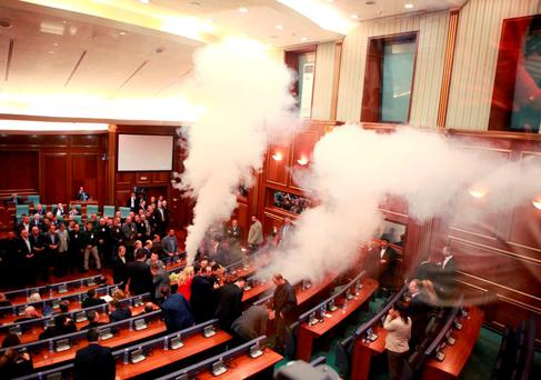 Opposition politicians release tear gas in parliament to obstruct a scheduled session in Pristina REUTERS/Hazir Reka