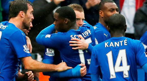 Leicester City's Jamie Vardy celebrates scoring their first goal with Jeffrey Schlupp and teammates Action Images via Reuters / Andrew Boyers Livepic