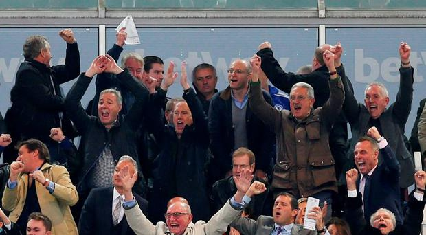 Chelsea manager Jose Mourinho in the stands dejected as West Ham fans celebrate their second goal Reuters / Eddie Keogh Livepic