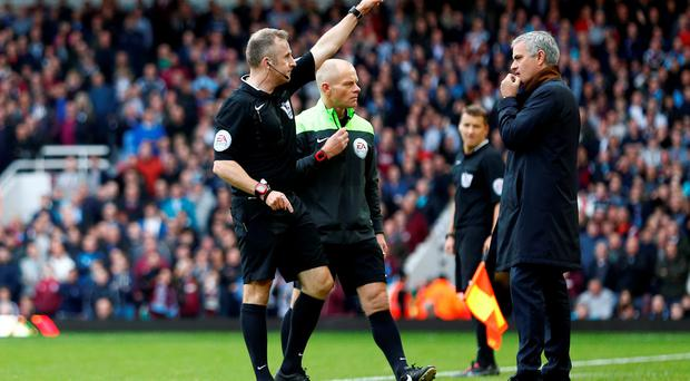 Chelsea manager Jose Mourinho looks on as referee Jonathan Moss sends him to the stands