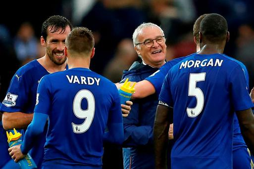 Leicester manager Claudio Ranieri celebrates at full time with their players