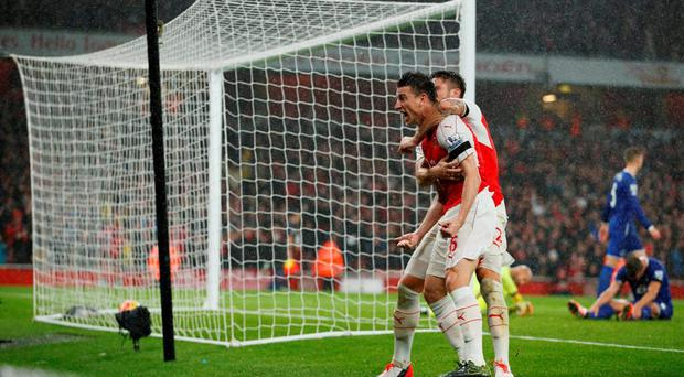 Arsenal's Laurent Koscielny celebrates scoring their second goal with Olivier Giroud