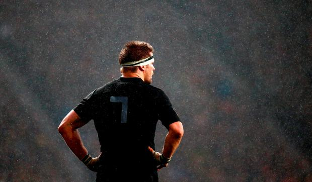New Zealand All Blacks captain Richie McCaw of the stands with his hands on his hips as the rain falls