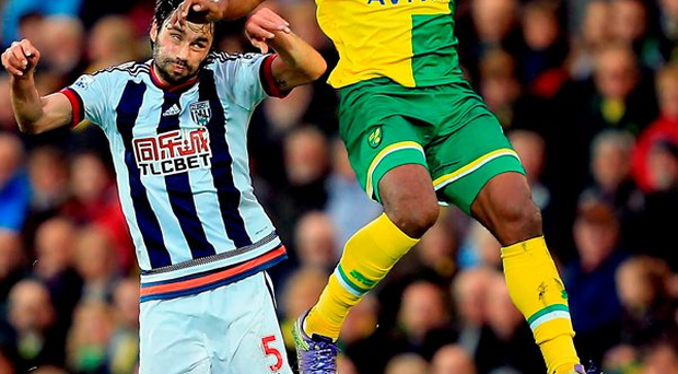 Norwich City's Cameron Jerome competes with Claudio Yacob for control of the ball