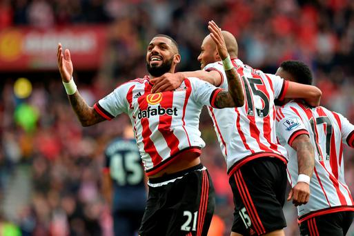 Sunderland's Yann M'Vila (left) celebrates their second goal of the game scored by team-mate Billy Jones (not in picture) during the Barclays Premier League match at the Stadium of Light, Sunderland. PRESS ASSOCIATION Photo. Picture date: Sunday October 25, 2015. See PA story SOCCER Sunderland. Photo credit should read: Owen Humphreys/PA Wire. RESTRICTIONS: EDITORIAL USE ONLY. No use with unauthorised audio, video, data, fixture lists, club/league logos or
