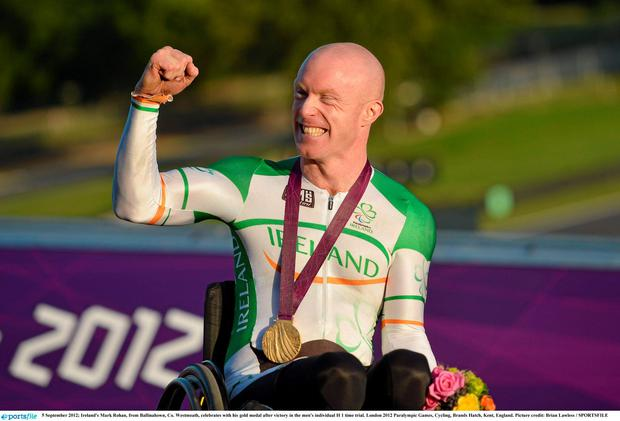 5 September 2012; Ireland's Mark Rohan, from Ballinahown, Co. Westmeath, celebrates with his gold medal after victory in the men's individual H 1 time trial. London 2012 Paralympic Games, Cycling, Brands Hatch, Kent, England. Picture credit: Brian Lawless / SPORTSFILE
