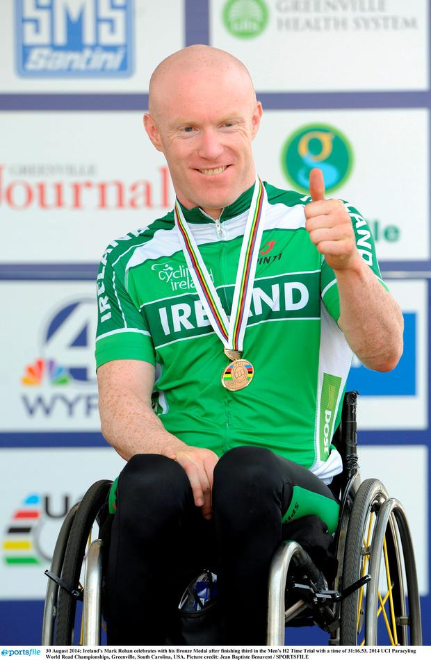 30 August 2014; Ireland's Mark Rohan celebrates with his Bronze Medal after finishing third in the Men's H2 Time Trial with a time of 31:16.53. 2014 UCI Paracyling World Road Championships, Greenville, South Carolina, USA. Picture credit: Jean Baptiste Benavent / SPORTSFILE