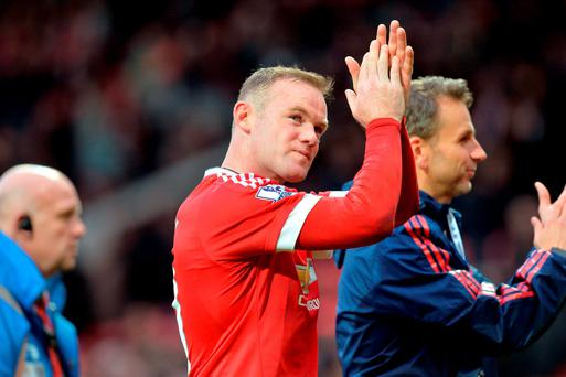 Manchester United's Wayne Rooney applauds the fans after the final whistle of the Barclays Premier League match at Old Trafford, Manchester