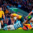 Rob Simmons of Australia is tackled by Ramiro Herrera of Argentina during the 2015 Rugby World Cup Semi Final match between Argentina and Australia at Twickenham