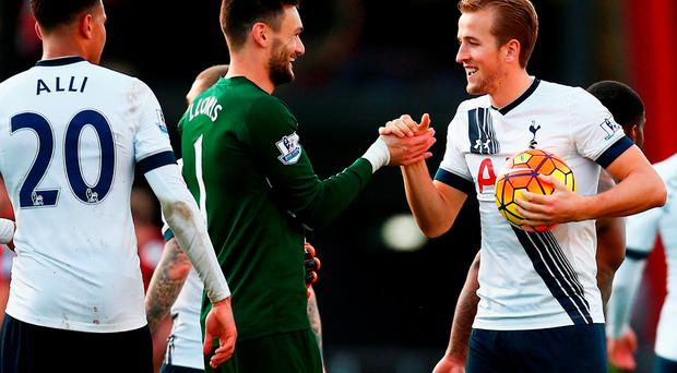 Harry Kane of Tottenham Hotspur holding the match ball to celebrate his hat-trick shakes hands with Hugo Lloris after the 5-1 win in the Barclays Premier League match between A.F.C. Bournemouth and Tottenham Hotspur