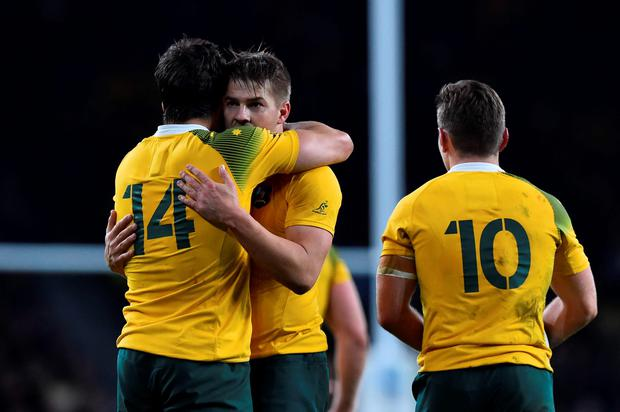 Australia's wing Adam Ashley-Cooper (L) celebrates with Australia's wing Drew Mitchell (C) after scoring his third and his team's fourth try during a semi-final match of the 2015 Rugby World Cup between Argentina and Australia at Twickenham
