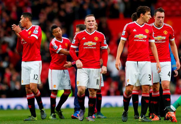 Manchester United's Wayne Rooney and teammates at full time Reuters / Eddie Keogh Livepic