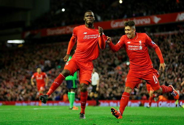 Football - Liverpool v Southampton - Barclays Premier League - Anfield - 25/10/15 Liverpool's Christian Benteke celebrates scoring their first goal with Roberto Firmino Action Images via Reuters / Alex Morton Livepic EDITORIAL USE ONLY. No use with unauthorized audio, video, data, fixture lists, club/league logos or