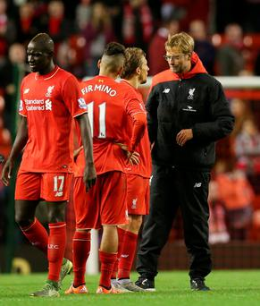 Football - Liverpool v Southampton - Barclays Premier League - Anfield - 25/10/15 Liverpool manager Juergen Klopp with Lucas Leiva, Roberto Firmino and Mamadou Sakho after the match Action Images via Reuters / Alex Morton Livepic EDITORIAL USE ONLY. No use with unauthorized audio, video, data, fixture lists, club/league logos or