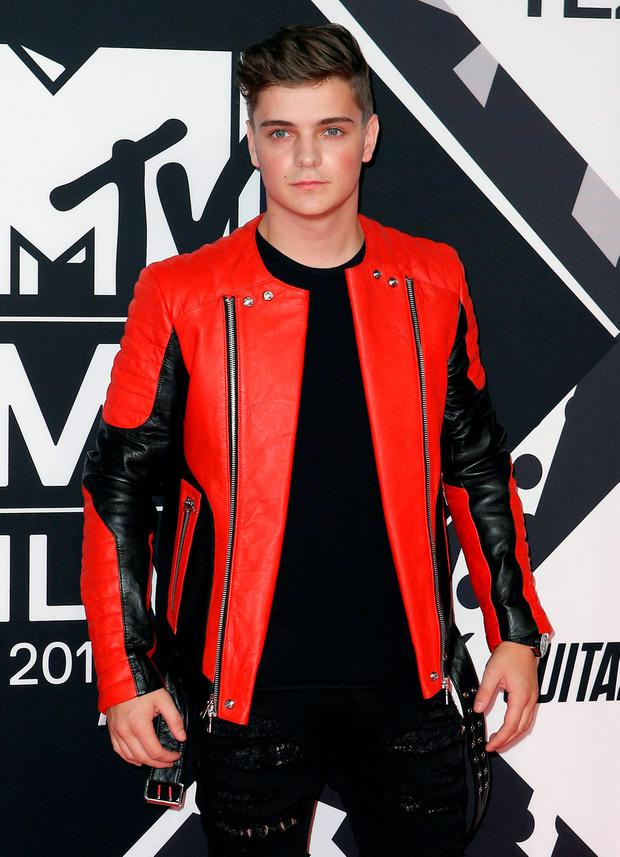 Martin Garrix poses on the red carpet during the MTV EMA awards at the Assago forum in Milan, Italy, October 25, 2015. REUTERS/Alessandro Garofalo