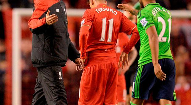Liverpool's Jurgen Klopp (L) speaks to Southampton's Ryan Bertrand (R) after the English Premier League football match between Liverpool and Southampton at Anfield stadium in Liverpool