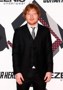 British singer Ed Sheeran poses on the red carpet during the MTV EMA awards at the Assago forum in Milan, Italy, October 25, 2015. REUTERS/Alessandro Garofalo