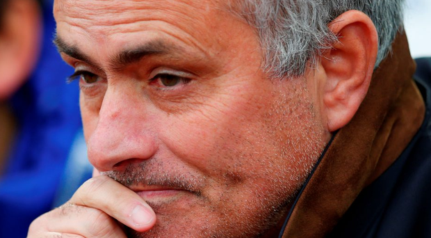Jose Mourinho deep in thought in the dug-out at Upton Park before being ordered to sit in the stand