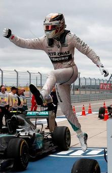 Lewis Hamilton leaps from his car after clinching the World Championship
