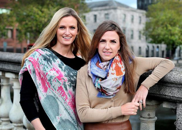 Keira and Dairine Kennedy model their KDK scarves inspired by a photograph they took beside Dublin's Four Courts. Photo: Steve Humphreys