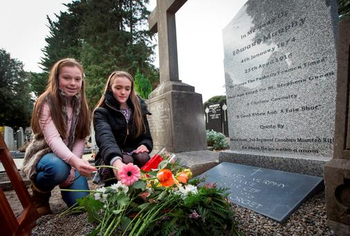 Mea Joblin (9) and her cousin Kate O'Grady (11), Edward Murphy's great great grandchildren, at the unveiling at Glasnevin Cemetery yesterday. Photo: Fergal Phillips