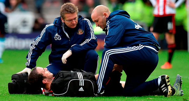Sunderland's John O'Shea is treated for a hamstring injury before being brought off the field