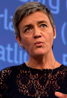 European Commissioner for Competition Margrethe Vestager speaks during a media conference at EU headquarters in Brussels on Wednesday, Oct. 21, 2015. The European Union is demanding that U.S. coffee chain Starbucks and carmaker Fiat repay up to 30 million euros ($34 million) each in tax breaks they received from EU nations, in a major ruling to cut down on sweet tax deals global multinationals often shop for. (AP Photo/Virginia Mayo)