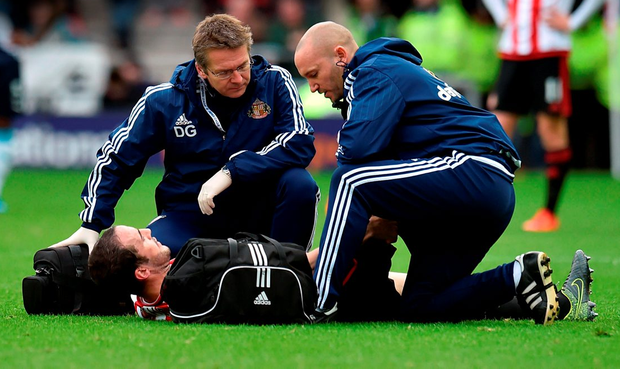 Sunderland's John O'Shea is treated for an injury before being brought off during the Premier League match at Sunderland