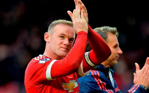 Manchester United's Wayne Rooney applauds the fans after the final whistle of the Barclays Premier League match at Old Trafford