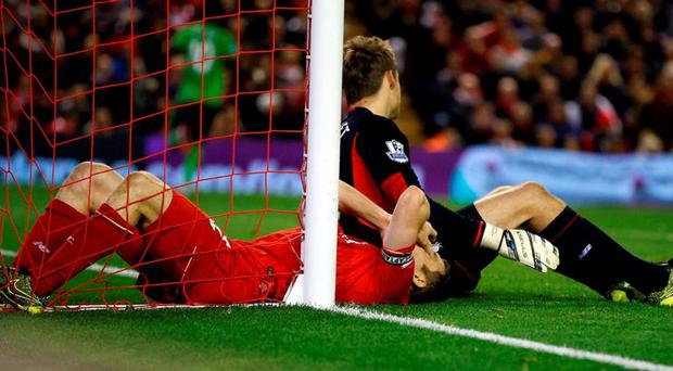 Liverpool's James Milner and goalkeeper Simon Mignolet appear dejected as Southampton's Sadio Mane (background) celebrates scoring his side's equalising goal of the game during the Barclays Premier League match at Anfield
