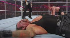 The Undertaker lies motionless on the canvas