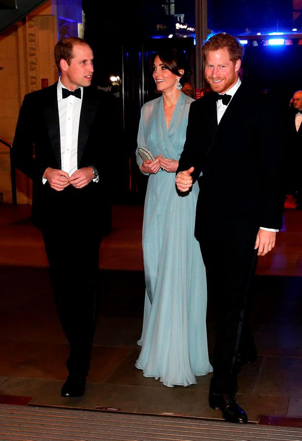 Prince William, Duke of Cambridge (L), Catherine, Duchess of Cambridge (C) and Prince Harry (R) attend The Cinema and Television Benevolent Fund's Royal Film Performance 2015 of the 24th James Bond Adventure,