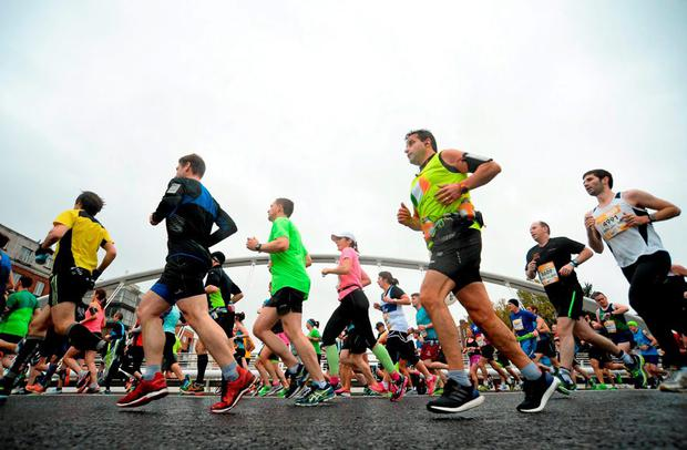 Runners make their way across the James Joyce Bridge during the SSE Airtricity Dublin marathon