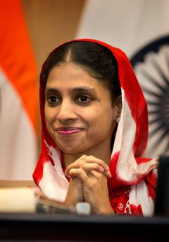 Geeta, who accidentally strayed into Pakistan as a child 12 years ago, smiles during a press conference in New Delhi, India. Photo: AP