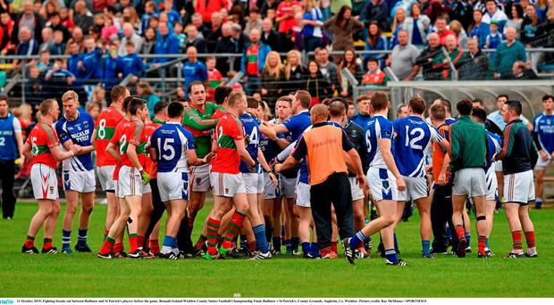 11 October 2015; Fighting breaks out between Rathnew and St Patrick's players before the game. Renault Ireland Wicklow County Senior Football Championship Final, Rathnew v St Patrick's. County Grounds, Aughrim, Co. Wicklow. Picture credit: Ray McManus / SPORTSFILE