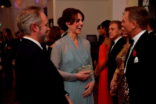 LONDON, ENGLAND - OCTOBER 26: Catherine, Duchess of Cambridge talks with Daniel Craig while attending The Cinema and Television Benevolent Fund's Royal Film Performance 2015 of the 24th James Bond Adventure,