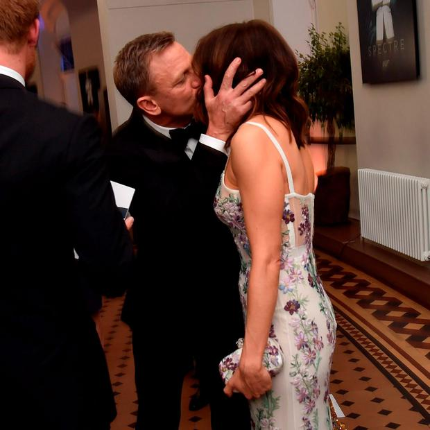 LONDON, ENGLAND - OCTOBER 26: Daniel Craig kisses his wife Rachel Weisz while they attend The Cinema and Television Benevolent Fund's Royal Film Performance 2015 of the 24th James Bond Adventure,