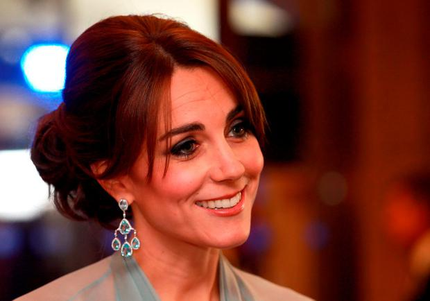 Britain's Catherine, Duchess of Cambridge meets charity representatives as she attends the world premiere of the new James Bond film 'Spectre' at the Royal Albert Hall in London