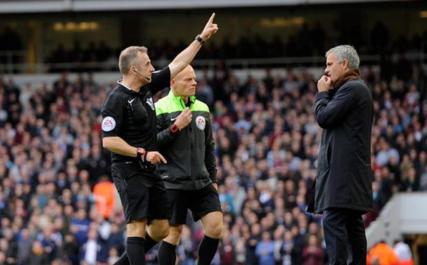 Referee Jonathan Moss sends Chelsea manager Jose Mourinho to the stands during the Barclays Premier League match between West Ham United and Chelsea
